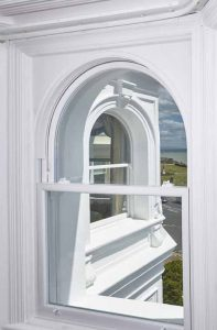 Heritage Rose arched uPVC sash window