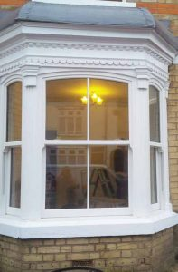 Large white uPVC sash windows