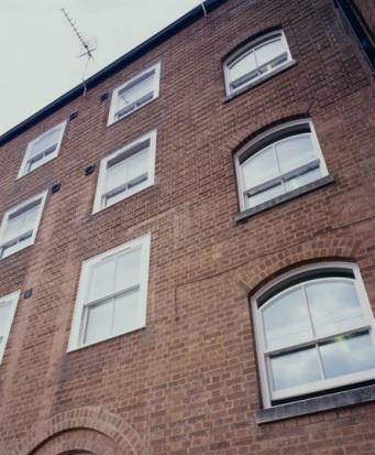 Metro house white window installation