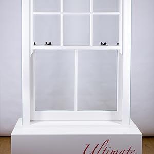 a white sash window on a white plinth