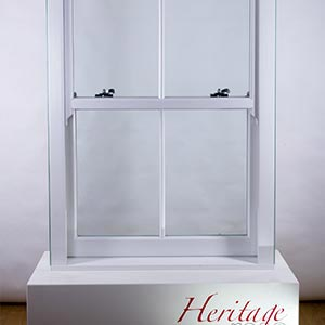 a heritage white sash window on a white plinth