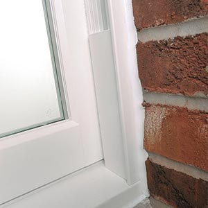 close up of a window bottom rail in a redbrick wall