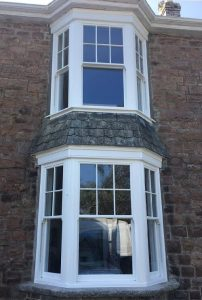 Sliding sash bay window 2 story installation