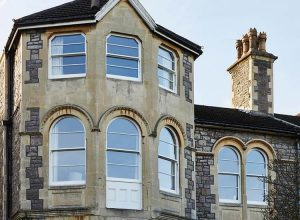 Large bay windows with arched sliding sash frames