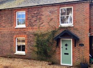 Country cottage with sliding sash windows installed