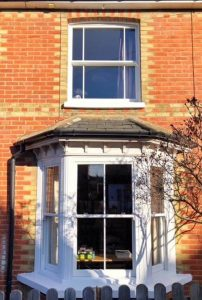 White sliding sash bay window