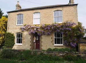 Wisteria cottage with sliding sash windows