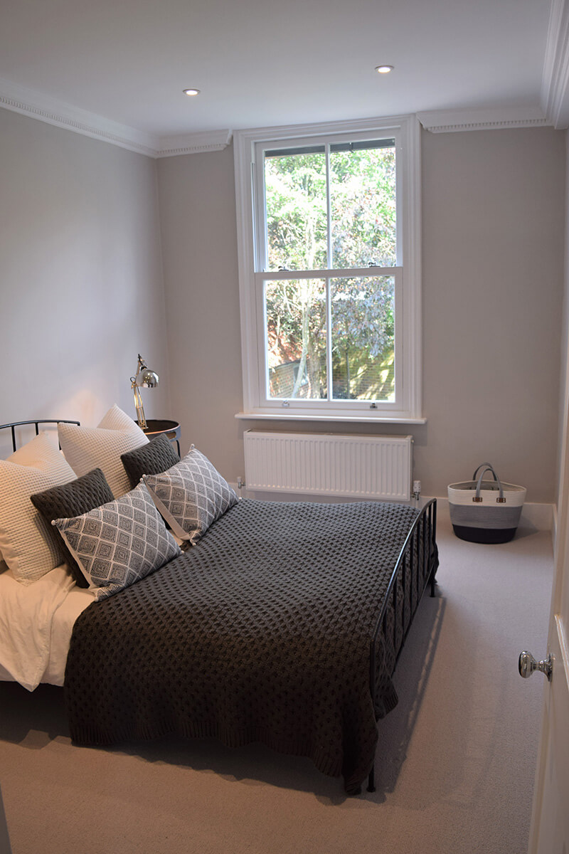 Millwater cottage bedroom interior with victorian sliders