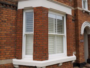 Ultimate rose white upvc bay windows on red brick house