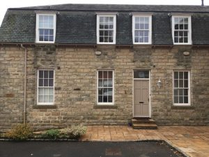 ultimate rose windows on stone cottage