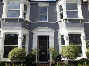 ultimate rose windows on grey house