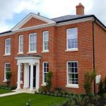 Red brick detached house with sliding sash windows