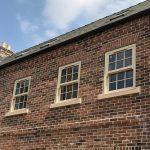 Three cream sliding sash windows